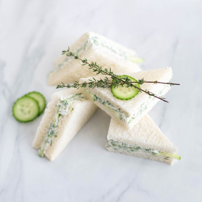 Mini cucumber and dill cream cheese sandwiches.