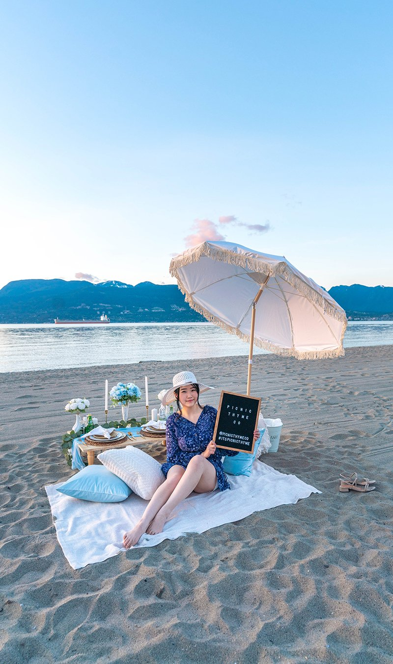 Light blue-themed Seas the Day beach picnic at Spanish Banks.